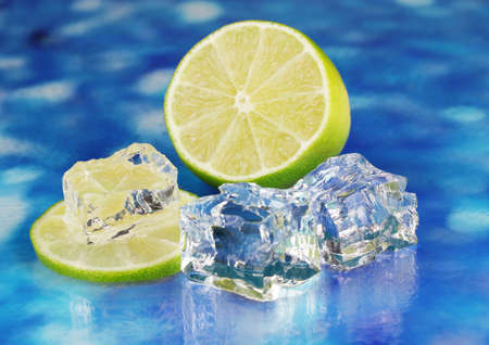 Ice cubes with lime on blue background Stock Photo - 17399651