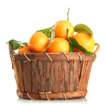 Ripe sweet tangerine with leaves in basket, isolated on white Stock Photo - 17399352