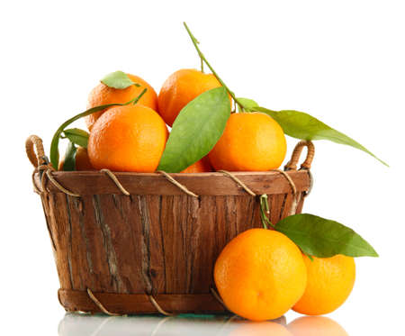 Ripe sweet tangerine with leaves in basket, isolated on white Stock Photo - 17399354