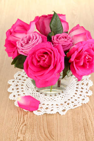 Beautiful pink roses in vase on wooden table close-up Stock Photo - 17399672