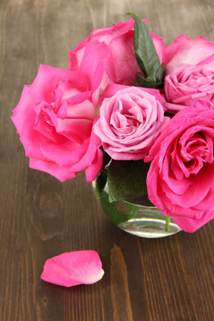 Beautiful pink roses in vase on wooden table close-up Stock Photo - 17399599