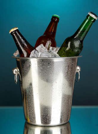 darck: Beer bottles in ice bucket on darck blue background