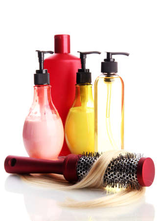 comb brush with hair and cosmetic bottles, isolated on white Stock Photo - 17399289