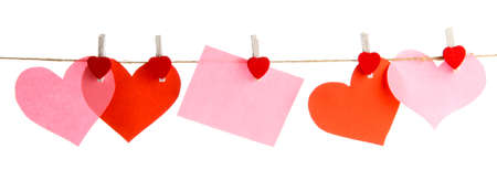 paper hearts and card on rope, isolated on white photo