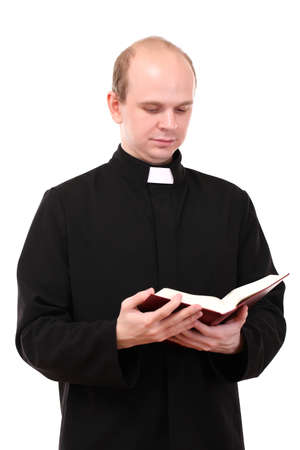 clerical: Young pastor with Bible, isolated on white