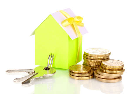 Small house with money and key isolated on white Stock Photo - 17458722