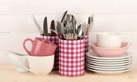Cups, bowls nd other utensils in metal containers isolated on light background Stock Photo - 17458810