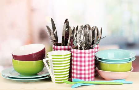 Cups, bowls nd other utensils in metal containers isolated on light background Stock Photo - 17458797