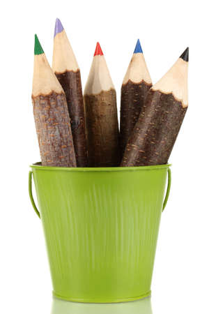 Colorful wooden pencils in green pail isolated on white photo