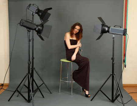 beautiful professional female model resting between shots in photography studio shoot set-up Stock Photo - 17761845