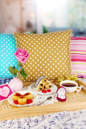 Breakfast in bed on Valentine's Day on room background photo