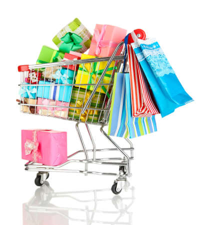 Christmas gifts and shopping in trolley isolated on white Stock Photo - 17476833