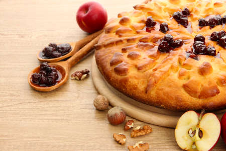tasty homemade pie with jam and apples, on wooden table Stock Photo - 17477361