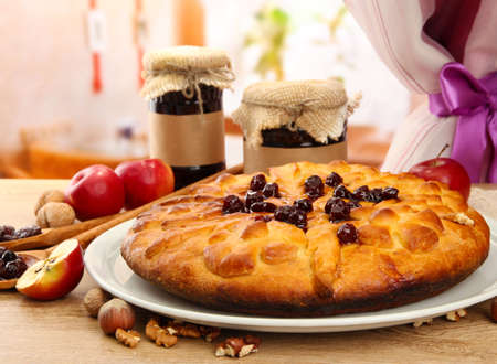 tasty homemade pie with jam and apples, on wooden table in cafe Stock Photo - 17477219