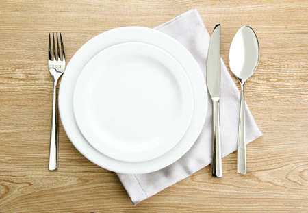 feast table: Table setting on wooden table