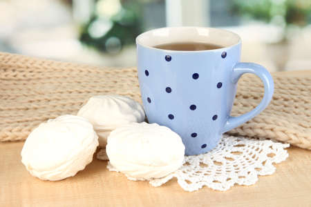 cup of tea with scarf on table in room Stock Photo - 17515954