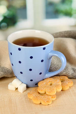 cup of tea with scarf on table in room Stock Photo - 17515957