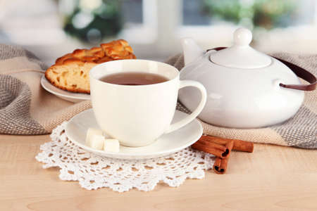 cup of tea with scarf on table in room Stock Photo - 17516489