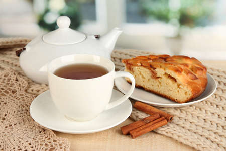 cup of tea with scarf on table in room Stock Photo - 17516491
