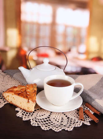 cup of tea with scarf on table in room Stock Photo - 17515913