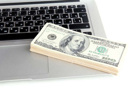 Money on laptop isolated on white photo