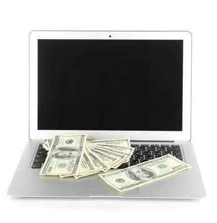 Money on laptop isolated on white Stock Photo - 17511953