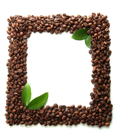 Coffee beans with leaves isolated on white photo