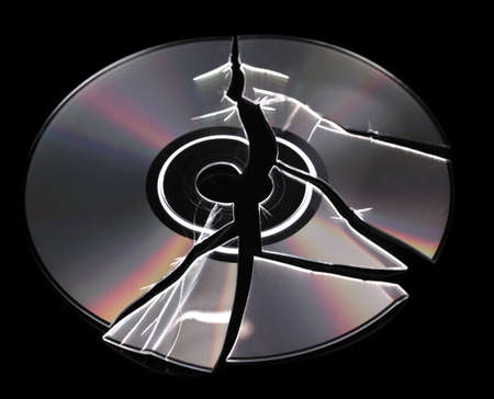 compromising: Broken disk with information isolated on black Stock Photo