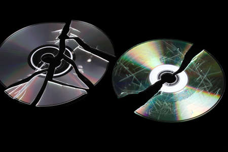 compromising: Defective and broken disks with information isolated on black