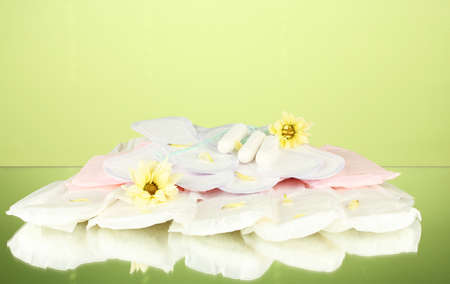 vaus types of sanitary pads and tampons on green background close-up Stock Photo - 17517027