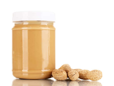 peanut butter: Delicious peanut butter in jar of peanut near isolated on white