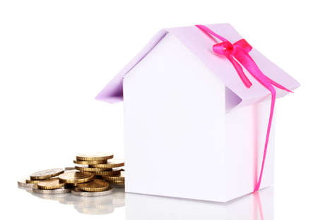 Small house with money isolated on white Stock Photo - 17516638