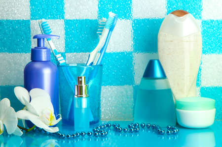 Bath accessories on shelf in bathroom on blue tile wall background Stock Photo - 17520480