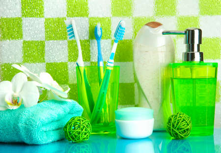 Bath accessories on shelf in bathroom on green tile wall background Stock Photo - 17521133