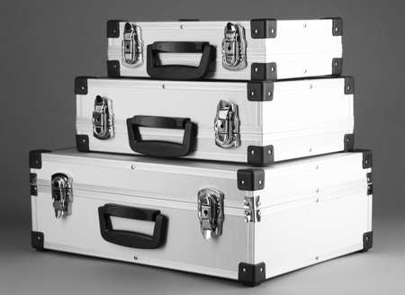 Silvery suitcases on grey background Stock Photo - 17520864