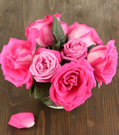 Beautiful pink roses in vase on wooden table close-up Stock Photo - 17519441