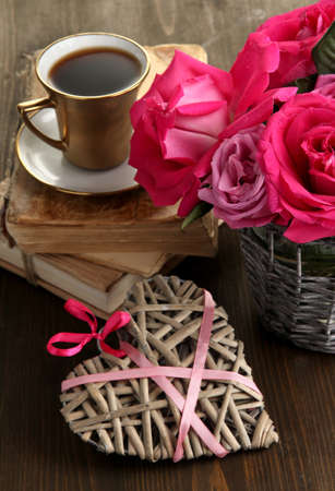 Beautiful pink roses in vase on wooden table close-up Stock Photo - 17520516