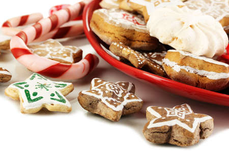 Christmas treats on plate isolated on white photo