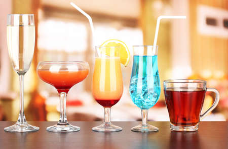 Several glasses of different drinks on bright background Stock Photo - 17520242