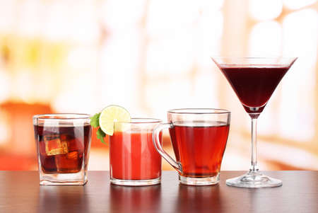 Several glasses of different drinks on bright background Stock Photo - 17516774