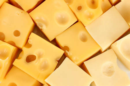 Cheese cubes background photo