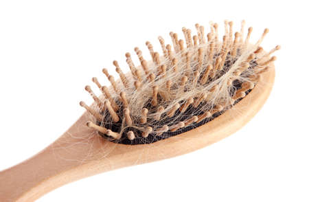 chemo: comb brush with lost hair, isolated on white
