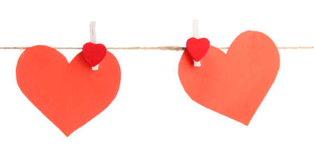 two paper hearts on rope, isolated on white photo