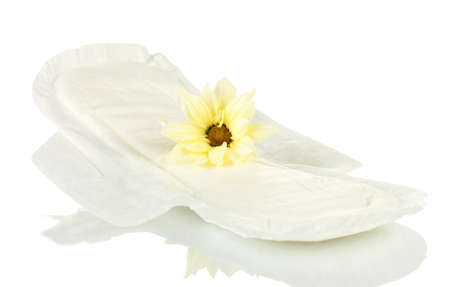 Panty liner and yellow flower isolated on white photo