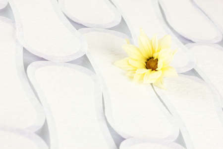 Daily panty liners and yellow flower on white background close-up Stock Photo - 17527947