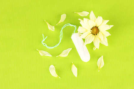 cotton tampon with yellow flower on green background close-up Stock Photo - 17527998