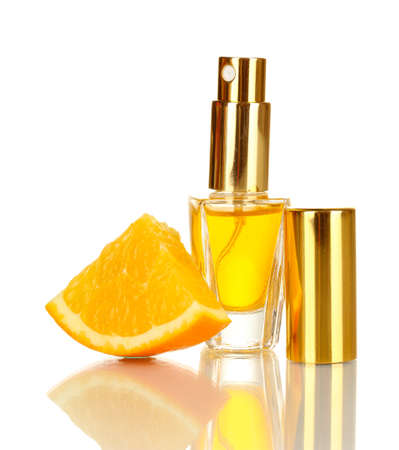 Women's perfume in beautiful bottle with orange isolated on white Stock Photo - 17527927