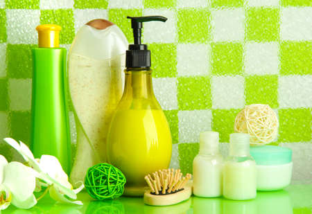 Bath accessories on shelf in bathroom on green tile wall background Stock Photo - 17528070