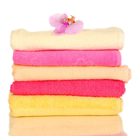 Stack of towels with fragrant flower isolated on white Stock Photo - 17527987