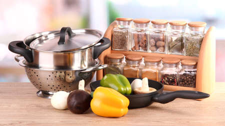 kitchen appliances: composition of kitchen tools,spices and vegetables on table in kitchen